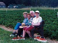 Seniors wait for a ride after picking strawberries